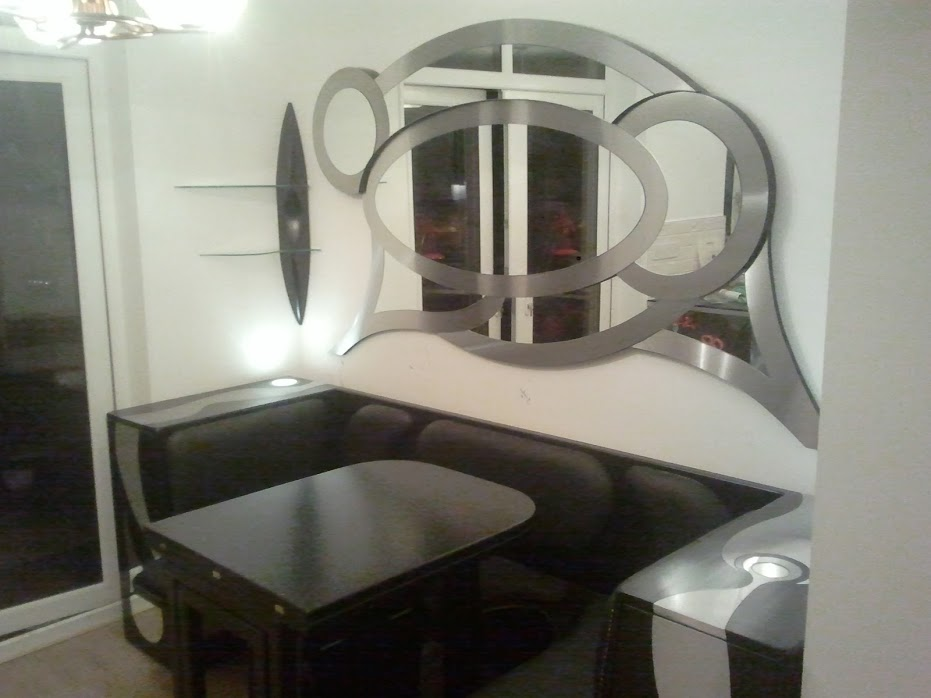 Kitchen Unit with Artistic Mirror and Folding Table and Chairs